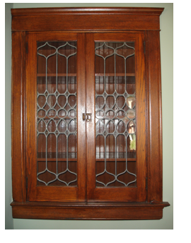 Original leaded glass built-ins with beadboard interior are not an unusual find in our neighborhood.