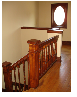 This lovely staircase, hardwoods and the decorative oval window spell charm.